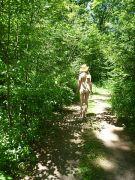450px-Nudist_woman_walking_in_forest_01