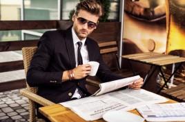 man-reading-a-newspaper-e1440023119255